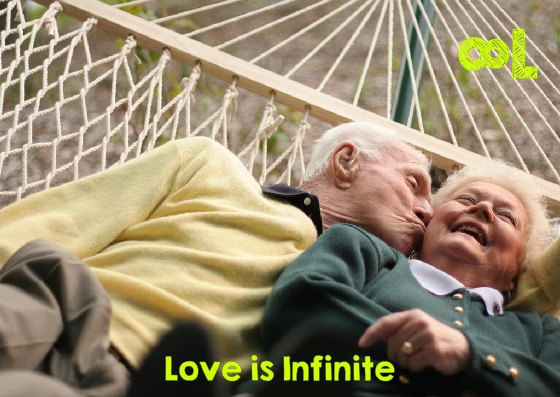 Old couple on a hammock kissing and cuddling.