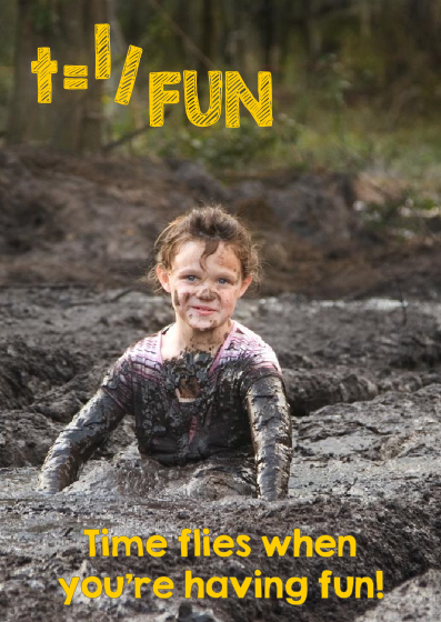 A little girl playing in the mud
