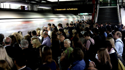 A crowded tube station in rush hour